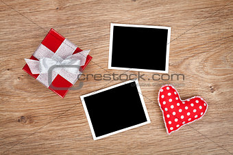 Blank photo frames and small red gift box