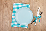 Fork with knife, blank plates and napkin