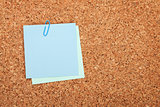 Blank postit note on cork notice board