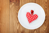 Valentine's Day toy heart over plate