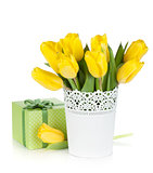 Yellow tulips in a vase and gift box