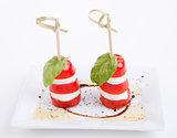tasty tomatoe mozzarella salad with basil on white