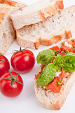 deliscious fresh bruschetta appetizer with tomatoes isolated