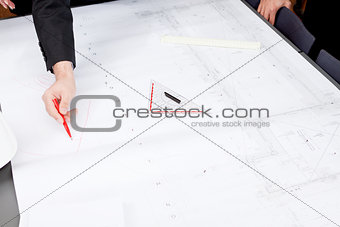 business people discussing architecture plan sketch