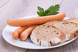 tasty sausages frankfurter with grain bread