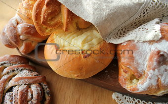 Fresh buns on wooden table