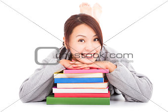 asian young  student lying on stacked books
