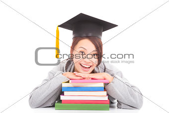 Portrait of happy student leaning on stacked books