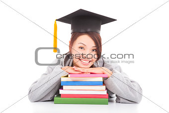 asian smiling  student leaning on stacked books