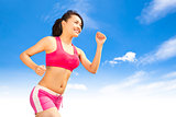 asian smiling runner woman jogging in sunny day