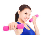 Young woman working out with dumbbells in her hands