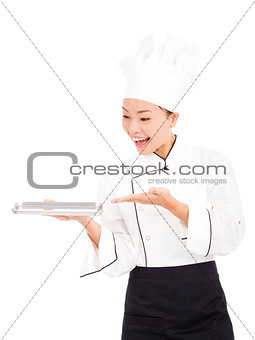 asian woman chef holding tray and showing