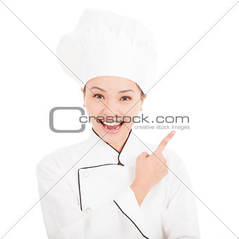 Portrait of young woman chef pointing direction
