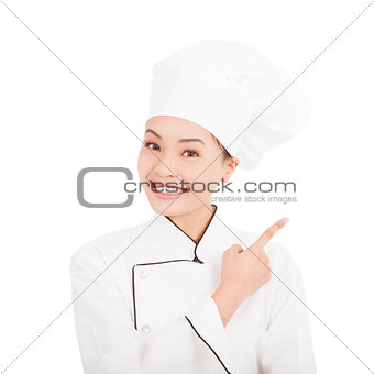 Asian young woman chef pointing direction