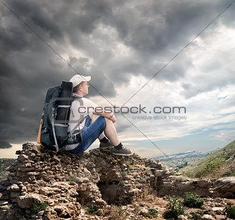 Tourist sitting on the rocks