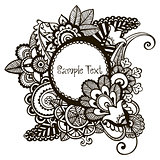 Hand drawn vector frame with floral design elements.