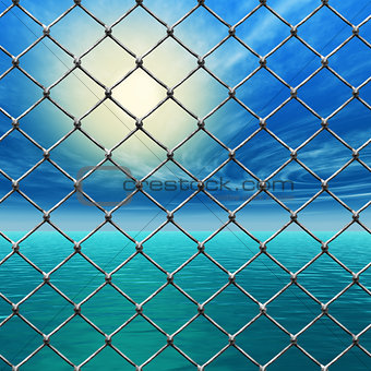 Freedom - Link fence over sunny sky and sea