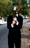 Burying Face In Funeral Flowers