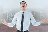Composite image of shouting businessman