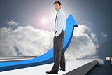 Composite image of smiling businessman standing with hands in pockets