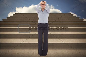 Composite image of desperate businesswoman