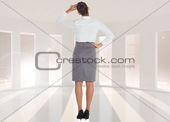 Composite image of businesswoman scratching her head
