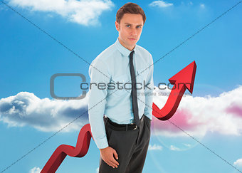 Composite image of serious businessman with hand in pocket