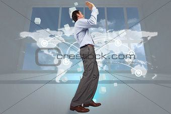 Composite image of businessman posing with hands up