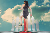 Composite image of businesswoman stepping up