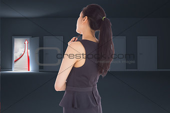 Composite image of thoughtful asian businesswoman