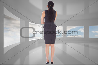 Composite image of thoughtful businesswoman