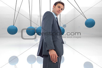 Composite image of stern businessman standing
