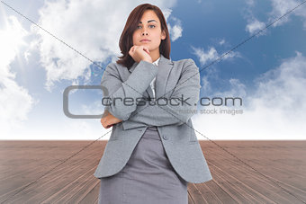 Composite image of focused businesswoman