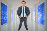 Composite image of cheerful businessman standing with hands on hips