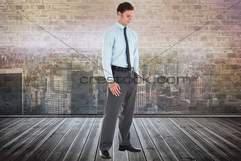 Composite image of serious businessman standing with hand in pocket