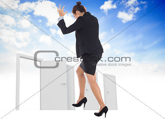 Composite image of businesswoman gesturing