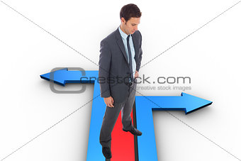 Composite image of stern businessman standing with hand on hip