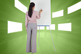 Composite image of businesswoman painting on an easel