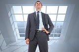 Composite image of cheerful businessman with hand on hip