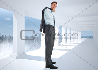 Composite image of serious businessman holding his jacket