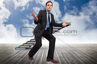 Composite image of businessman posing with arms outstretched