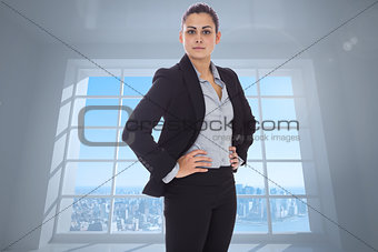 Composite image of serious businesswoman