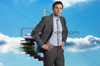 Composite image of serious businessman with hands on hips