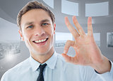 Composite image of businessman showing ok sign