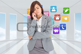 Composite image of thinking upset businesswoman