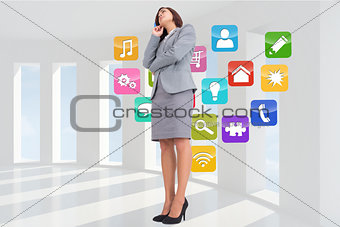 Composite image of worried businesswoman