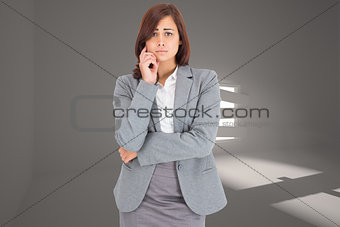 Composite image of upset thinking businesswoman