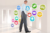 Composite image of happy businessman standing with hands in pockets