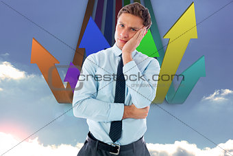 Composite image of upset thinking businessman