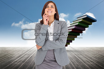Composite image of thinking happy businesswoman